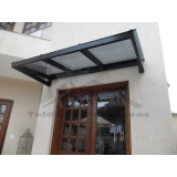 instalação de cobertura de policarbonato para porta preço Jardim Europa